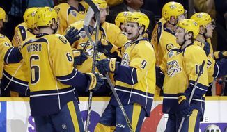 Nashville Predators center Filip Forsberg (9), of Sweden, celebrates with teammates after scoring a goal against the San Jose Sharks in the third period of an NHL hockey game Saturday, Feb. 6, 2016, in Nashville, Tenn. (AP Photo/Mark Humphrey)
