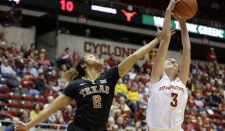 Iowa State guard Emily Durr grabs a rebound over Texas guard Celina Rodrigo, left, during the first half of an NCAA college basketball game, Saturday, Feb. 6, 2016, in Ames, Iowa. (AP Photo/Charlie Neibergall)
