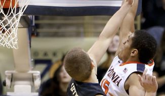 Virginia's Malcolm Brogdon, right, gets around Pittsburgh's Ryan Luther (4) to dunk during the first half of an NCAA college basketball game, Saturday, Feb. 6, 2016, in Pittsburgh. (AP Photo/Keith Srakocic)