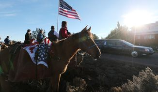 Mourners use a riderless horse to honor LaVoy Finicum during his funeral in Kanab, Utah, on Friday. Mr. Finicum was shot to death by law enforcement while he and other anti-government activists flocked to rural Oregon in a dispute over public lands. (Associated Press)