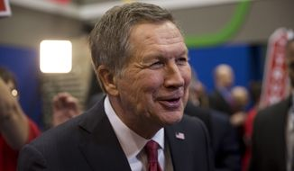 Republican presidential candidate, Ohio Gov. John Kasich speaks with members of the media after a Republican presidential primary debate hosted by ABC News at the St. Anselm College Saturday, Feb. 6, 2016, in Manchester, N.H. (AP Photo/Matt Rourke)