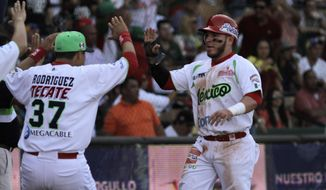 Jesus Esteban Quiroz of Mexico's Venados de Mazatlan, celebrates with his teammates during a Caribbean Series baseball final against Venezuela's Tigres de Aragua, in Santo Domingo, Dominican Republic, Sunday, Feb. 7, 2016. (AP Photo/Roberto Guzman)