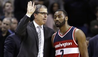 Washington Wizards coach Randy Wittman huddles with John Wall during the second half of the team's NBA basketball game against the Charlotte Hornets in Charlotte, N.C., Saturday, Feb. 6, 2016. The Hornets won 108-104. (AP Photo/Bob Leverone)