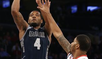 Georgetown guard D'Vauntes Smith-Rivera (4) scored 24 points in the Hoyas' 92-67 win over St. John's on Monday night. (Associated Press) **FILE**
