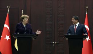 "German Chancellor Angela Merkel, left, speaks to the media during a joint news conference with Turkish Prime Minister Ahmet Davutoglu in Ankara, Turkey, Monday, Feb. 8, 2016. Turkey and Germany agreed on Monday on a set of measures to deal with the Syrian refugee crisis, including a joint diplomatic initiative aiming to halt attacks against Syria's largest city. Merkel said after talks with Davutoglu that she is ""not just appalled but horrified"" by the suffering caused by Russian bombing in Syria. (AP Photo/Burhan Ozbilici)"