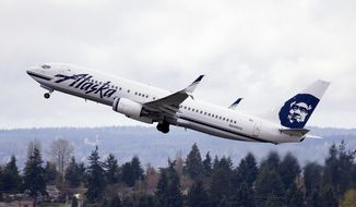 In this photo taken March 24, 2015, an Alaska Airlines jet takes off at Seattle-Tacoma International Airport in SeaTac, Wash. A U.N. panel on Feb. 8, 2016, proposed long-sought greenhouse gas emissions standards for airliners and cargo planes beginning in 2020 for new aircraft designs and three years later for designs already in production. The International Civil Aviation Organization said the agreement reached by 170 international experts sets a cutoff date of 2028 for the manufacture of planes that don't comply with the standards. (AP Photo/Elaine Thompson, File)