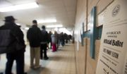 A ballot is posted to the wall as voters wait in line to cast their ballots for the New Hampshire primary at a polling place Tuesday, Feb. 9, 2016, in Manchester, N.H. (AP Photo/David Goldman)