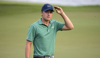 Jordan Spieth of the United States walks off the 18th hole after the final round of the SMBC Singapore Open golf tournament at Sentosa Golf Club's Serapong Course on Monday, Feb. 1, 2016, in Singapore. (AP Photo/Wong Maye-E)