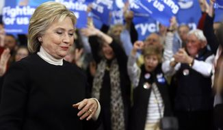 Democratic presidential candidate Hillary Clinton walks to the stage at her first-in-the-nation presidential primary campaign rally, Tuesday, Feb. 9, 2016, in Hooksett, N.H. Clinton lost to Bernie Sanders in New Hampshire. (AP Photo/Matt Rourke)