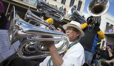 Members of the Bayou City Blues Band play from the back of a float while riding in 30th annual Krewe of Aquarius Parade on the first Saturday of Mardi Gras Festivities in downtown Galveston, Texas, Saturday, Jan. 30, 2016. (Stuart Villanueva/The Galveston County Daily News via AP) ** FILE **