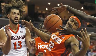 Virginia forward Anthony Gill (13) and Virginia Tech forward Zach LeDay (32) reach for a rebound during the first half of an NCAA college basketball game in Charlottesville, Va., Tuesday, Feb. 9, 2016. (AP Photo/Steve Helber)
