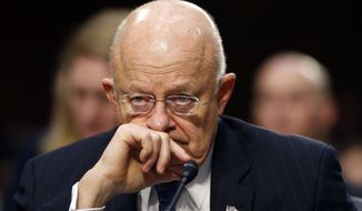 Director of the National Intelligence James Clapper participates in the Senate Intelligence Committee's hearing on worldwide threats, Tuesday, Feb. 9, 2016, on Capitol Hill in Washington. (AP Photo/Alex Brandon)