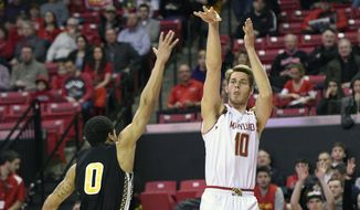 Maryland forward Jake Layman (10) takes a shot against Bowie State guard Dayshawn Wells (0) during the first half of an NCAA college basketball game, Tuesday, Feb. 9, 2016, in College Park, Md. (AP Photo/Nick Wass)