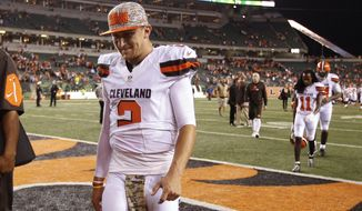 FILE- In this Nov. 5, 2015, file photo, Cleveland Browns quarterback Johnny Manziel walks off the field after the Browns lost 31-10 to the Cincinnati Bengals during an NFL football game in Cincinnati. The Browns said Tuesday, Feb. 9, 2016, that Manziel was diagnosed with a concussion late in the season by an independent neurologist, countering an NFL Network report they lied about the injury to cover up the troubled quarterback showing up intoxicated for practice. (AP Photo/Frank Victores, File)