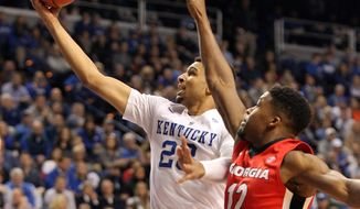 Kentucky's Jamal Murray, left, shoots under pressure from Georgia's Kenny Gaines during the first half of an NCAA college basketball game Tuesday, Feb. 9, 2016, in Lexington, Ky. (AP Photo/James Crisp)