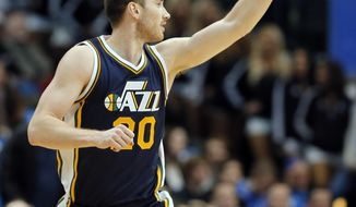 Utah Jazz's Gordon Hayward (20)  celebrates sinking a 3-point basket against the Dallas Mavericks in the first half of an NBA basketball game, Tuesday, Feb. 9, 2016, in Dallas. (AP Photo/Tony Gutierrez)