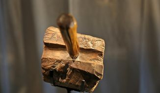 "A previously unknown artifact from Abraham Lincoln's life in Indiana is displayed at the Indiana State Museum, in Indianapolis, Tuesday, Feb. 9, 2016. Museum officials unveiled the wooden mallet they say Abraham used to make furniture when his family lived in southwestern Indiana during his youth. The mallet is inlayed with nails that form Lincoln's initials ""A.L"" and the year ""1829.""  (Kelly Wilkinson /The Indianapolis Star via AP)  NO SALES; MANDATORY CREDIT"