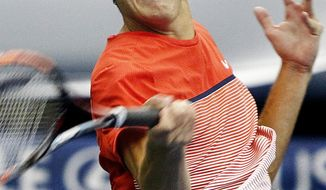 American Taylor Fritz hits a winner against fellow American Michael Mmoh during the second day of the Memphis Open tennis tournament at the Racquet Club in Memphis, Tenn., Tuesday, Feb. 9, 2016. Fritz defeated Mmoh. (Mark Weber/The Commercial Appeal via AP) MANDATORY CREDIT