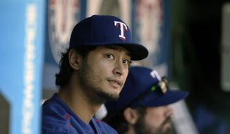 FILE - In this Sunday, Sept. 13, 2015 file photo, Texas Rangers pitcher Yu Darvish of Japan watches from dugout a baseball game against the Oakland Athletics in Arlington, Texas. (AP Photo/LM Otero, File)