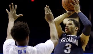 Villanova guard Josh Hart, right, shoots over DePaul guard Eli Cain during the first half of an NCAA college basketball game Tuesday, Feb. 9, 2016, in Rosemont, Ill. (AP Photo/Nam Y. Huh)