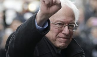 Democratic presidential candidate Sen. Bernie Sanders, I-Vt., raises a fist as he arrives for a breakfast meeting with Al Sharpton at Sylvia's Restaurant, Wednesday, Feb. 10, 2016, in the Harlem neighborhood of New York. Sanders defeated former Secretary of State Hillary Clinton on Tuesday in the New Hampshire primary. (AP Photo/Seth Wenig)