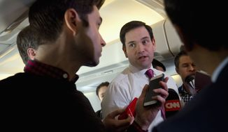 Republican presidential candidate, Sen. Marco Rubio, R-Fla. speaks to members of the traveling media on board his plane en route from New Hampshire to South Carolina, Wednesday Feb. 10, 2016, after the New Hampshire primary. (AP Photo/Jacquelyn Martin)