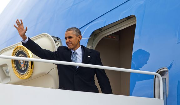 President Barack Obama waves while boarding Air Force One before his departure from Andrews Air Force Base,Md., Wednesday, Feb. 10, 2016. Obama is returning to Springfield, Ill., the place where his presidential career began, to mark the ninth anniversary of his entrance in the 2008 presidential race. He plans to deliver an address to the Illinois General Assembly at the Illinois State Capitol. (AP Photo/Pablo Martinez Monsivais)