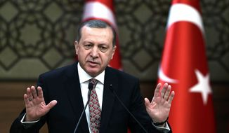 "Turkish President Recep Tayyip Erdogan addresses a meeting of local administrators at his palace in Ankara, Turkey, Wedesday, Feb. 10, 2016. Erdogan has ratcheted up his criticism of the United States for not recognizing Syrian Kurdish forces as ""terrorists,"" saying Washington's lack of knowledge of the groups operating in the region had led to bloodshed. Turkey considers the Kurdish Democratic Union Party, or PYD, which are affiliated with Turkey's own Kurdish rebels as a terrorist group.(Yasin Bulbul/Presidential Press Service, Pool via AP)"