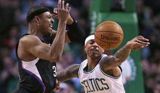 Boston Celtics guard Isaiah Thomas, right, knocks away a pass to Los Angeles Clippers forward Paul Pierce during the first quarter of an NBA basketball game in Boston, Wednesday, Feb. 10, 2016. (AP Photo/Charles Krupa)