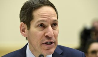 CDC Director Tom Frieden testifies on Capitol Hill in Washington, Wednesday, Feb. 10, 2016, before the House Foreign Affairs, Africa, Global Health, Global Human Rights, and International Organizations subcommittee and Western Hemisphere subcommittee hearing on: 'The Global Zika Epidemic.' (AP Photo/Susan Walsh)