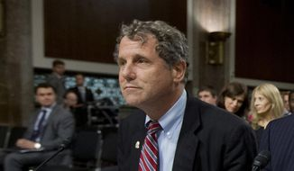 FILE - In this July 22, 2014, file photo, U.S. Sen. Sherrod Brown, D-Ohio, prepares to testify during a hearing on Capitol Hill in Washington. The lawmaker from Cleveland outlined a legislative proposal Wednesday, Feb. 10, 2016, intended to address the deadly drug overdose epidemic affecting many states, and like anti-heroin legislation previously introduced by his Republican counterpart, U.S. Sen. Rob Portman from the Cincinnati area, the proposal is billed as a comprehensive approach. (AP Photo, File)