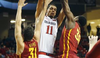 Texas Tech forward Zach Smith (11) pulls in a rebound between Iowa State forward Georges Niang (31) and Deonte Burton during the first half of an NCAA college basketball game, Wednesday, Feb. 10, 2016, in Lubbock, Texas. (AP Photo/Mark Rogers)