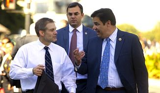 "Reps. Jim Jordan, left, Justin Amash, center, and Raul Labrador, right, are among lawmakers assembling Thursday for ""Conversation with Conservatives"" on Capitol Hill.  (AP Photo)"