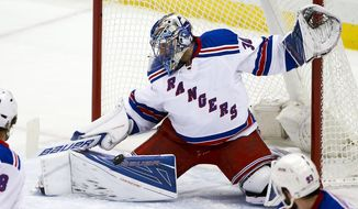 New York Rangers goalie Henrik Lundqvist (30) stops a shot during the first period of an NHL hockey game against the Pittsburgh Penguins in Pittsburgh, Wednesday, Feb. 10, 2016. (AP Photo/Gene J. Puskar)
