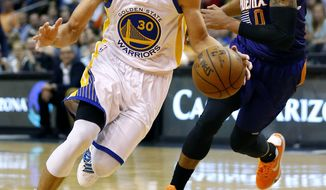 Golden State Warriors' Stephen Curry (30) drives past Phoenix Suns' Orlando Johnson during the first half of an NBA basketball game Wednesday, Feb. 10, 2016, in Phoenix. (AP Photo/Matt York)