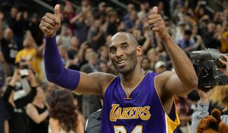Los Angeles Lakers guard Kobe Bryant gestures to fans as he walks off of the court after an NBA basketball game against the San Antonio Spurs, Saturday, Feb. 6, 2016, in San Antonio. San Antonio won 106-102. (AP Photo/Darren Abate)