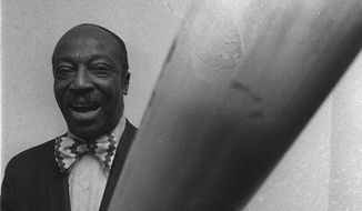 "James ""Cool Papa"" Bell poses with a huge bat after being inducted into the Baseball Hall of Fame, Feb. 14, 1974. Bell was unanimously voted into the hall by a seven man committee. (AP Photo/HMB)"