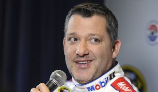 FILE - In this Jan. 21, 2016, file photo, Stewart Haas co-owner and driver Tony Stewart talks to members of the media during the NASCAR Charlotte Motor Speedway Media Tour in Charlotte, N.C. With four-time champion Jeff Gordon retired and three-time champ Tony Stewart sidelined with a broken back, the NASCAR season begins with a much different look and a new rules package.  (AP Photo/Mike McCarn, File)