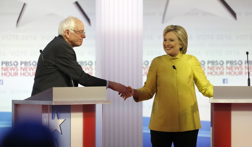 Democratic presidential candidates, Sen. Bernie Sanders, I-Vt, and Hillary Clinton shake hands after a Democratic presidential primary debate at the University of Wisconsin-Milwaukee, Thursday, Feb. 11, 2016, in Milwaukee. (AP Photo/Morry Gash) ** FILE **