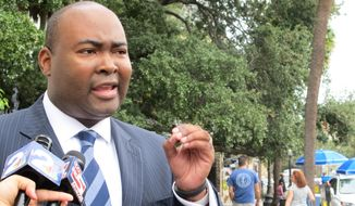 Jamie Harrison won the South Carolina Democratic Party's chairman position in 2013, breaking a barrier by becoming the first black person to hold the post. (Associated Press)