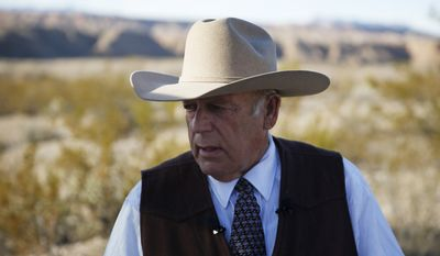 Rancher Cliven Bundy stands along the road near his ranch in this Jan. 27, 2016, file photo in Bunkerville, Nev. (AP Photo/John Locher)