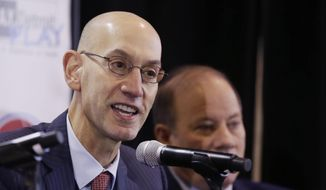FILE - In this Monday, Jan. 18, 2016 file photo, National Basketball Association commissioner Adam Silver, addresses the media at the S.A.Y. Detroit Play Center in Detroit. The first All-Star weekend held outside the U.S. is another success for Commissioner Adam Silver. And while things are going well, the honeymoon won't last long before either players or owners have to decide if they want the NBA to go in another direction.  (AP Photo/Carlos Osorio, File)