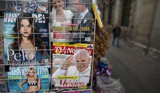 A magazine cover welcoming Pope Francis to Mexico is displayed for sale alongside fashion and gossip magazines at a newsstand in Mexico City, Wednesday, Feb. 10, 2016. The pontiff will arrive to Mexico on Friday, Feb. 12 for a week-long visit. (AP Photo/Rebecca Blackwell)