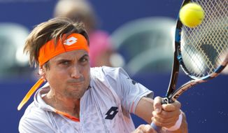 David Ferrer of Spain returns the ball to   Renzo Olivo of Argentina during the ATP Argentina Open in Buenos Aires, Argentina, Thursday, Feb. 11, 2016.(AP Photo/Natacha Pisarenko)