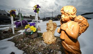 In this Thursday, Feb. 4, 16, 2016 photo, five crosses and two angels can be seen at 13th and Allen Streets, Allentown, Pa., where a memorial is set up at the site of fatal natural gas explosion that happened Feb. 9, 2011. Manuel Cruz went through unimaginable grief and recurring nightmares after losing his entire family in the explosion that rocked his former Allentown neighborhood. (April Bartholomew/The Morning Call via AP) MANDATORY CREDIT