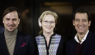The president of the International Jury of the 2016 Berlinale Film Festival Meryl Streep, center, poses with jury members Lars Eidinger, left, and Clive Owen for a photo on the eve of the film festival in Berlin, Wednesday, Feb. 10, 2016. (AP Photo/Markus Schreiber)