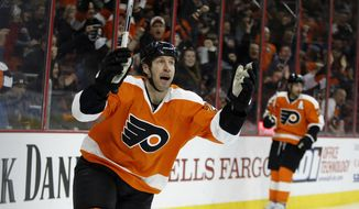 Philadelphia Flyers' R.J. Umberger celebrates after scoring a goal during the second period of an NHL hockey game against the Buffalo Sabres, Thursday, Feb. 11, 2016, in Philadelphia. (AP Photo/Matt Slocum)