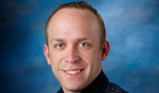 This undated photo released by Fargo Police Department shows Fargo police Officer Jason Moszer. Moszer who was shot amid a standoff in Fargo, N.D., with a domestic violence suspect, police in North Dakota said early Thursday, Feb. 10, 2016. (Fargo Police Department via AP)