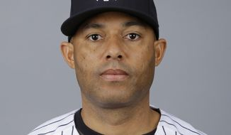FILE - This is a 2013, file photo showing Mariano Rivera of the New York Yankees baseball team. The Yankees will dedicate a plaque for retired relief pitcher Mariano Rivera in Monument Park on Aug. 14 before a game against Tampa Bay. Rivera, who retired after the 2013 season, helped New York win five World Series. He is the major league career saves leader in the regular season (652) and postseason (42). (AP Photo/Matt Slocum, File)