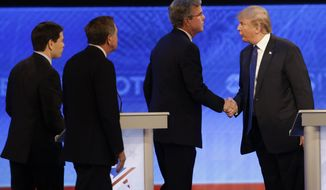 In this Feb. 6, 2016 photo, Republican presidential candidate Donald Trump  shakes hands with fellow candidate, former Florida Gov. Jeb Bush, followed by Ohio Gov. John Kasich and, Sen. Marco Rubio, R-Fla. after a Republican presidential primary debate in Manchester, N.H. The GOP field is suddenly streamlined after the first two voting contests, there's no greater certainty about who will emerge as the party's nominee. (AP Photo/David Goldman, File)